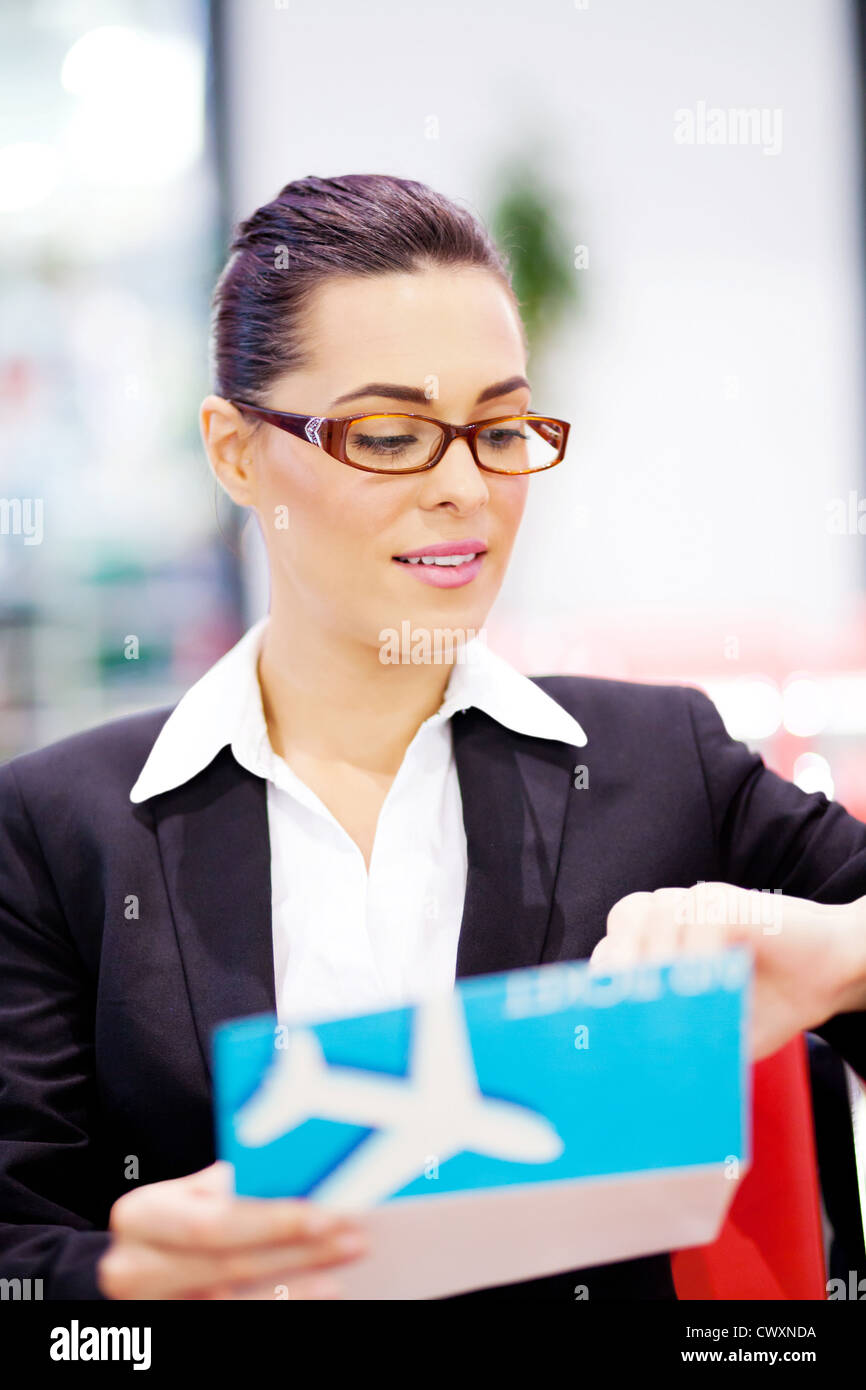 young businesswoman checking her flight time at airport Stock Photo