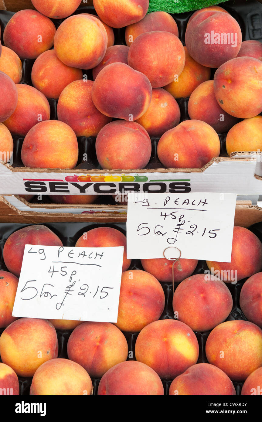 Boxes of peaches on sale during the Ludlow 2012 Food Festival - Stock Image