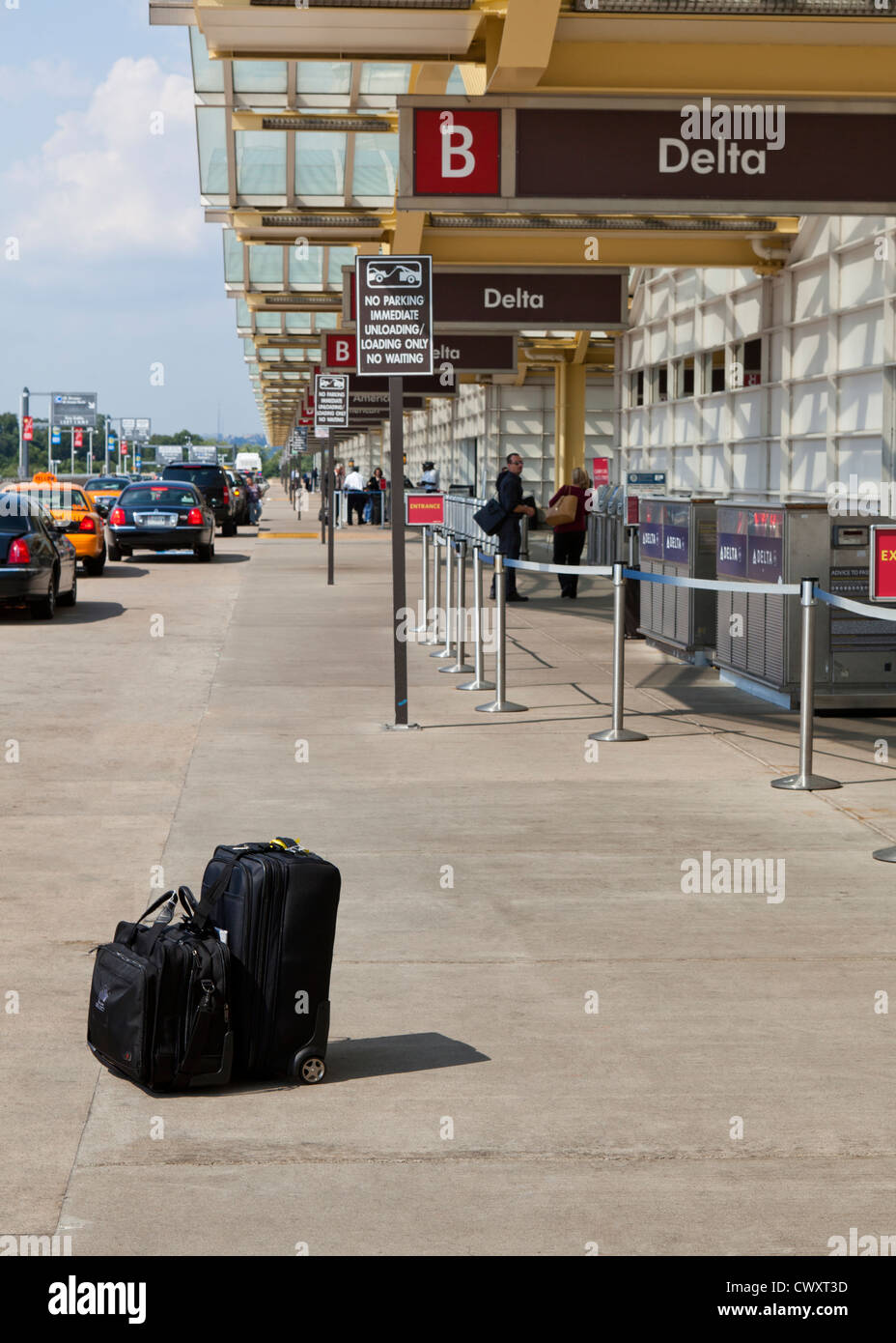 Unattended luggage at airport - Stock Image