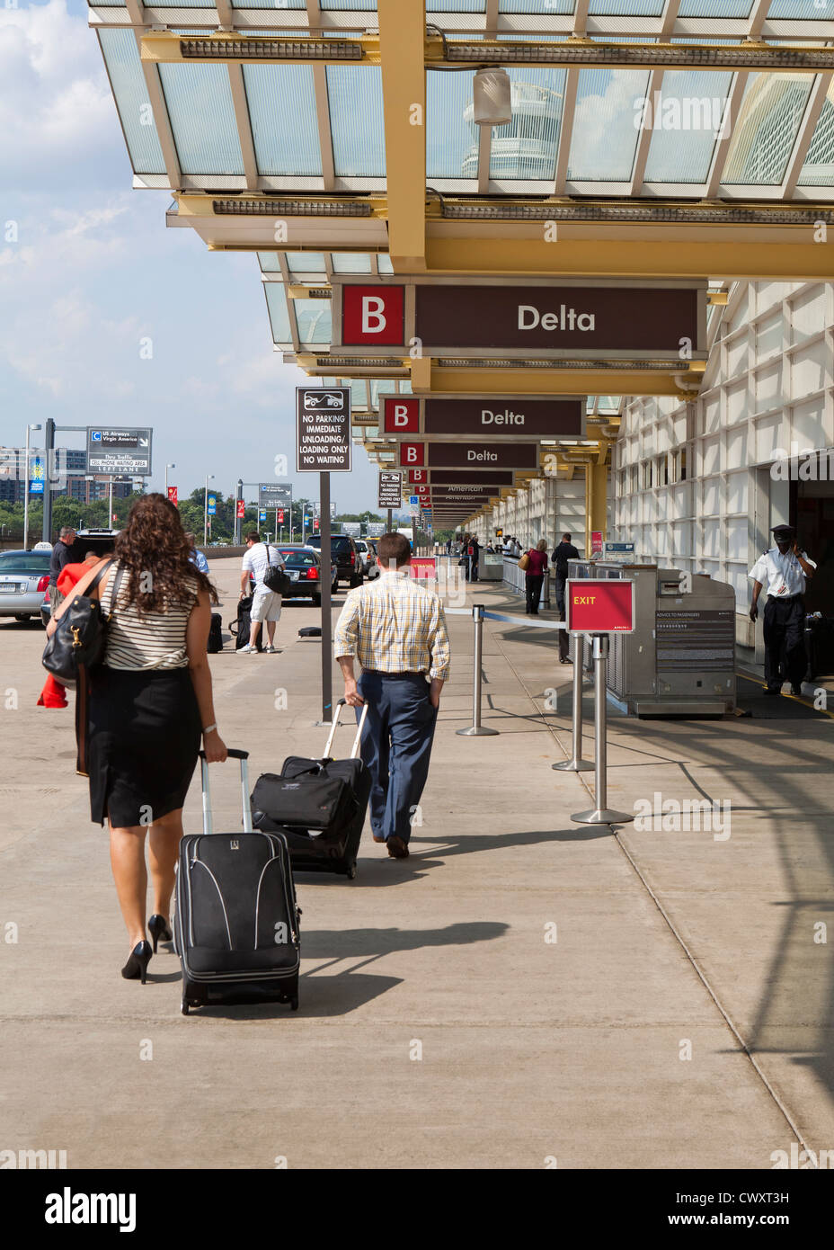 Curb-side baggage check-in area - Ronald Reagan National Airport (DCA)  - Washington, DC USA - Stock Image