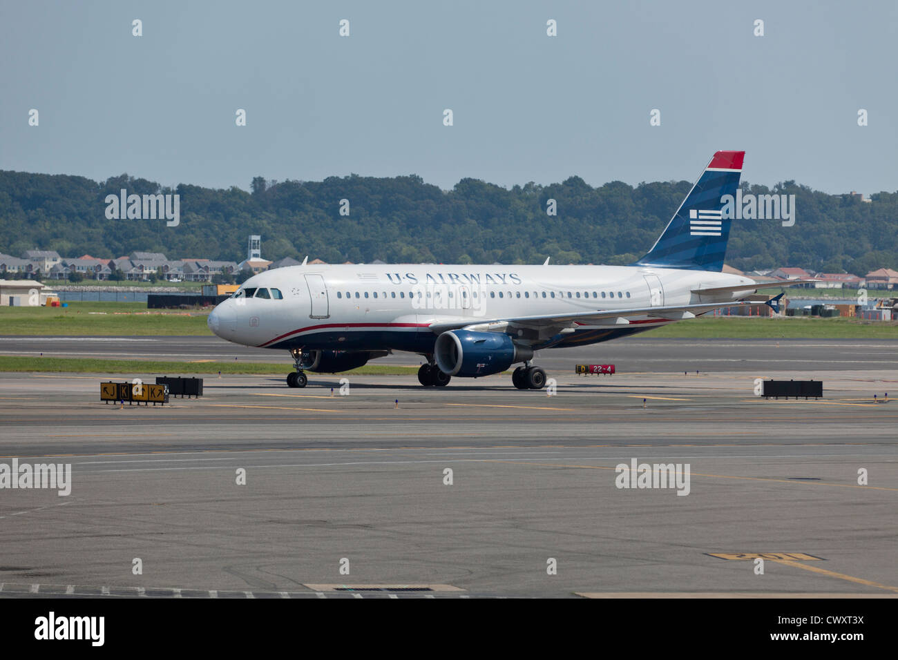 A US Airways commuter jet on the runway - Stock Image