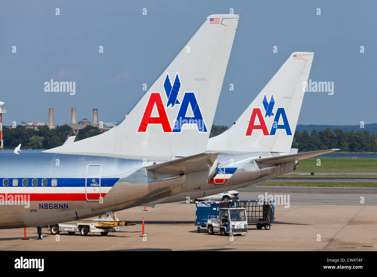 Vertical stabilizers of parked American Airlines jets - Ronald Reagan National Airport - Washington, DC USA - Stock Image