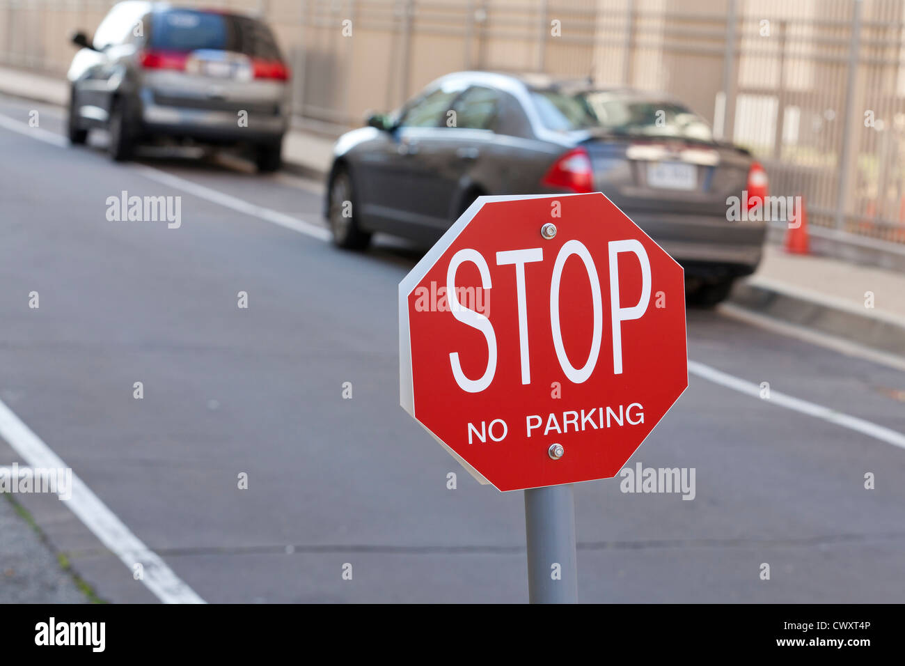 Stop - No Parking sign in alley - Stock Image