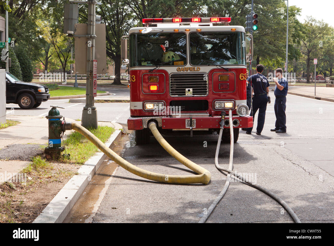 Routine pump check on a firetruck - USA - Stock Image