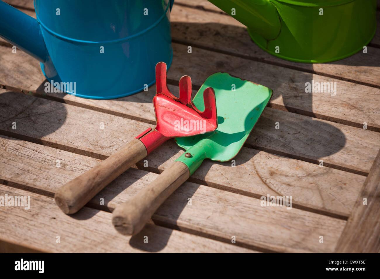 Colorful children's hand rake and shovel set - Stock Image