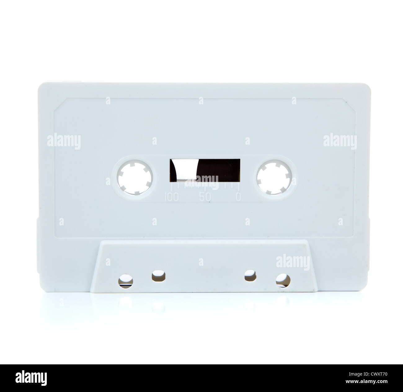A white cassette tape on a white background - Stock Image