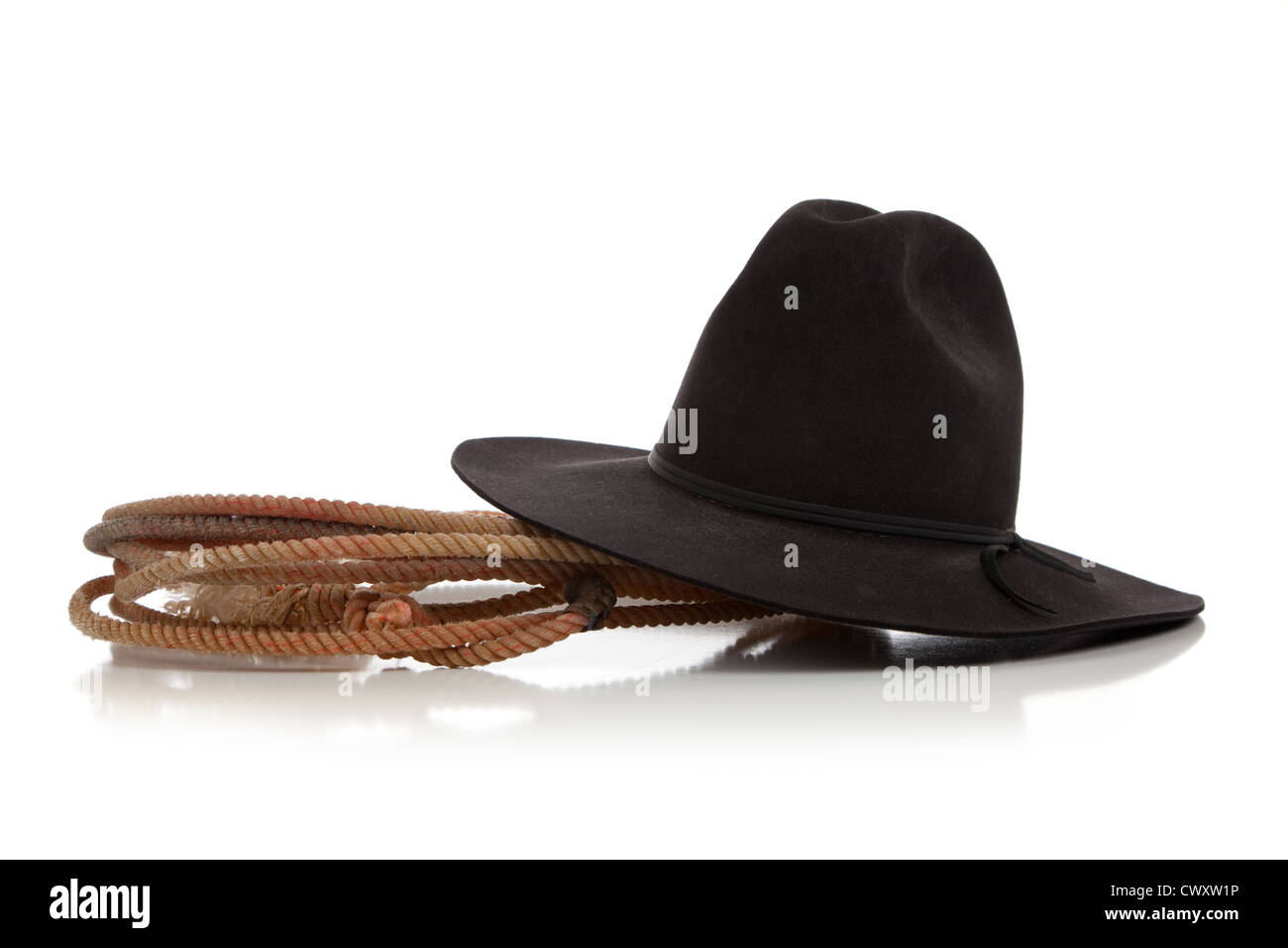 A lasso and black felt cowboy hat on a white background - Stock Image
