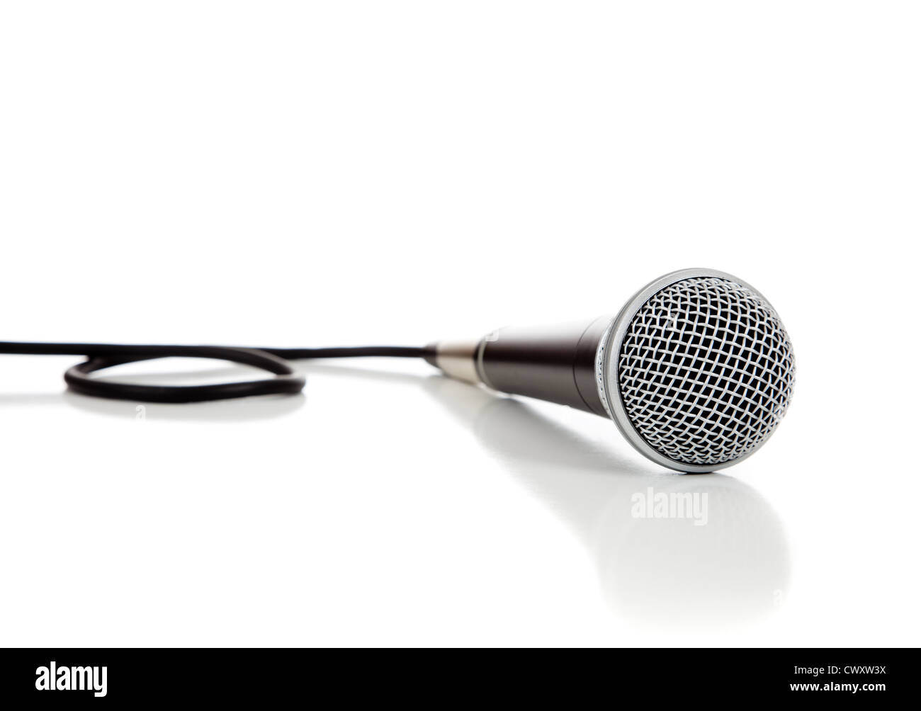 A black and silver mic on a white background - Stock Image