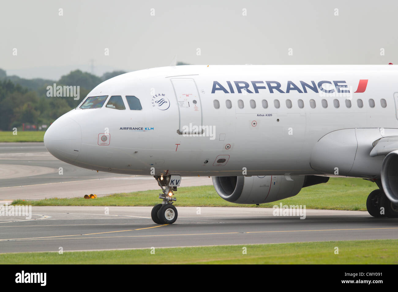 An Air France Airbus A320 taxiing on the runway of Manchester International Airport (Editorial use only) - Stock Image