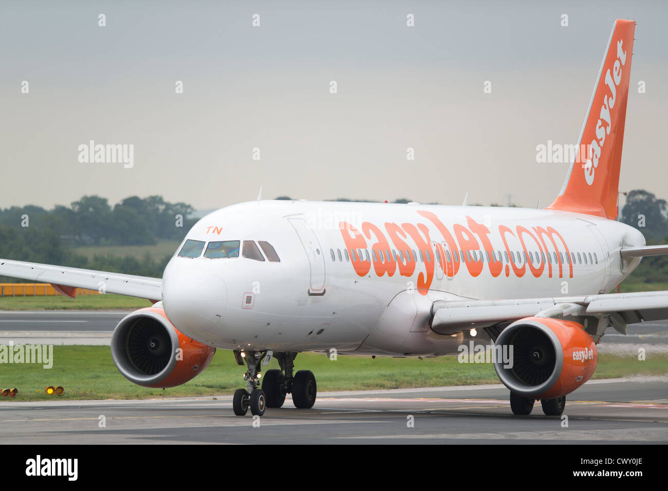 A EasyJet Airbus A319 taxiing on the runway of Manchester International Airport (Editorial use only) - Stock Image