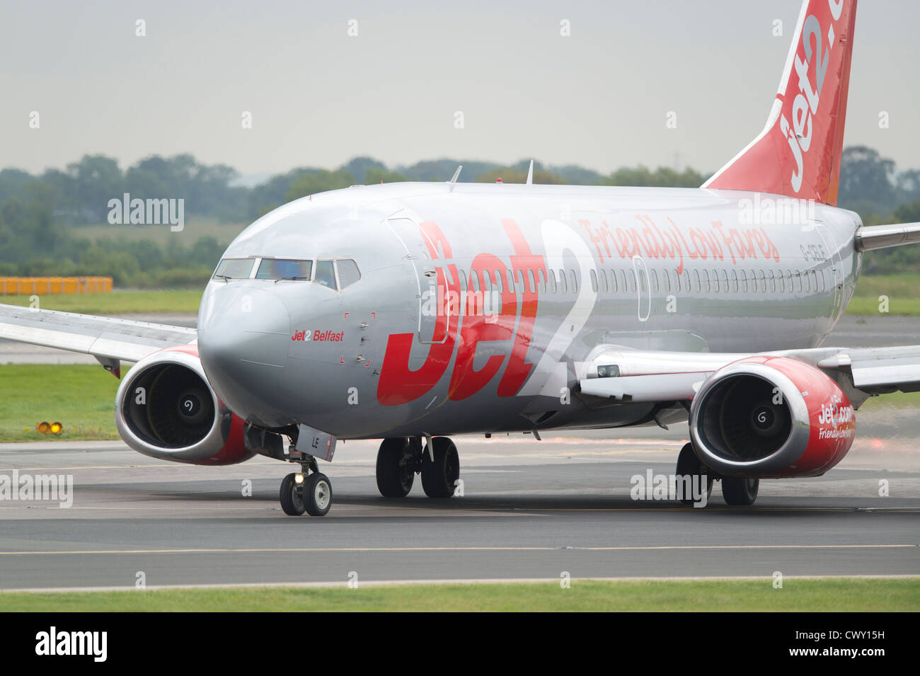 A Jet2 Boeing 737 taxiing on the runway of Manchester International Airport (Editorial use only) - Stock Image