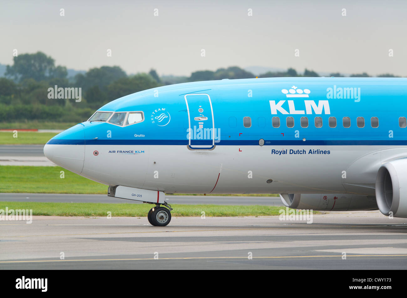 A KLM Dutch Royal Airlines Boeing 737 taxiing on the runway of Manchester International Airport (Editorial use only) - Stock Image