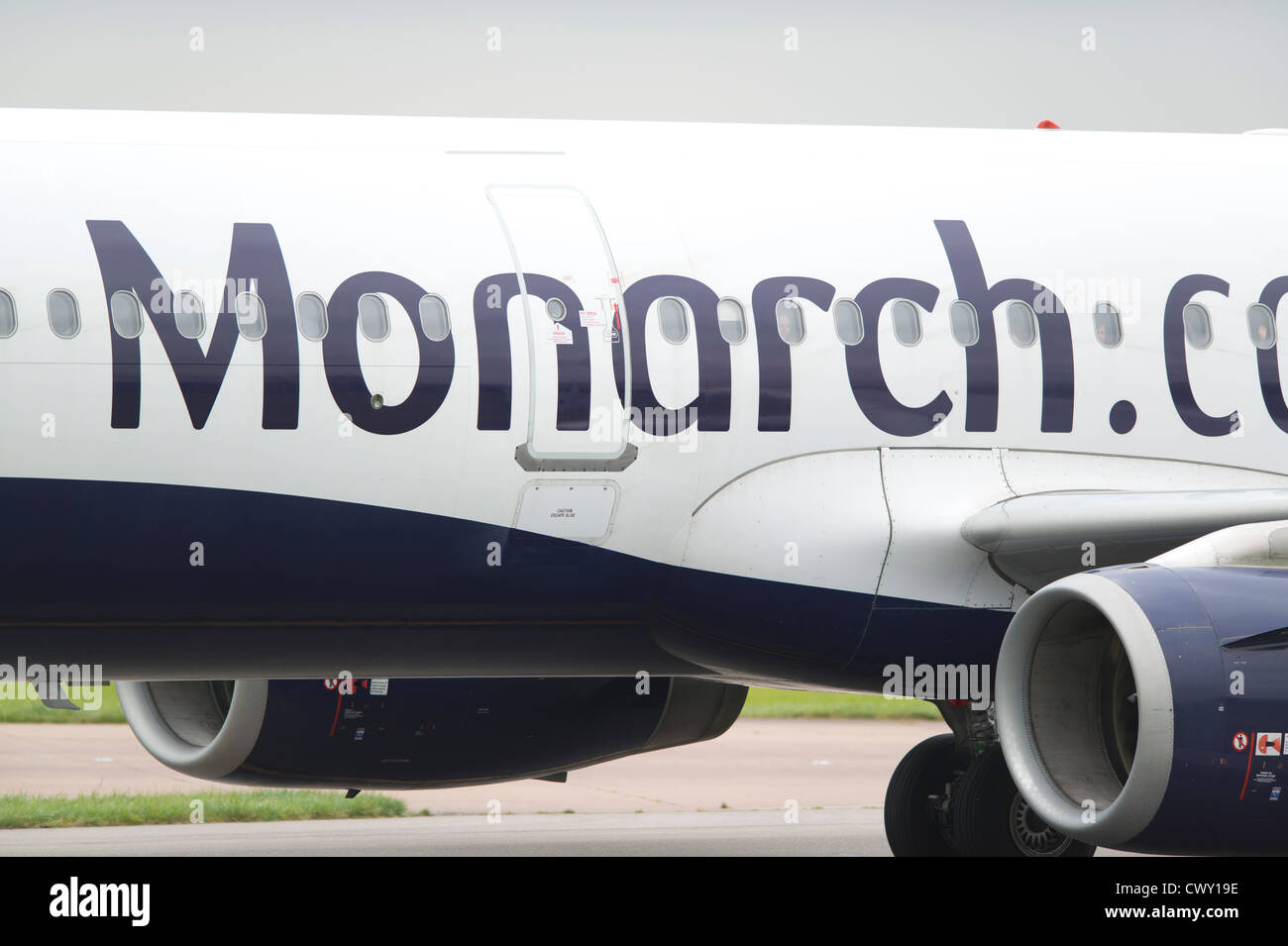 A close up of the Monarch Airlines logo on the fuselage of a passenger aircraft (Editorial use only) - Stock Image