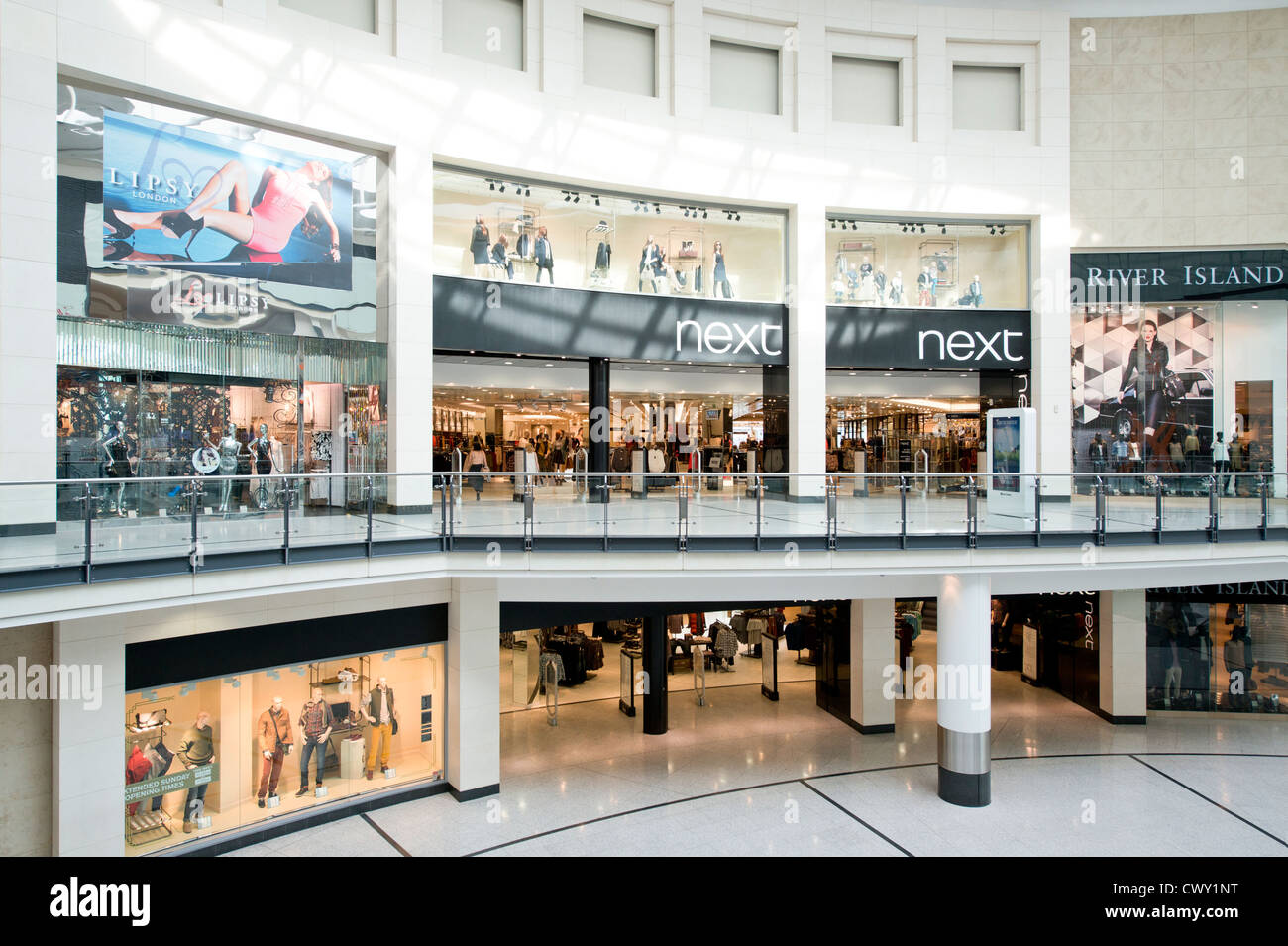 An indoor shot of the entrance / storefront of the Next flagship store in Manchester Arndale Centre. - Stock Image