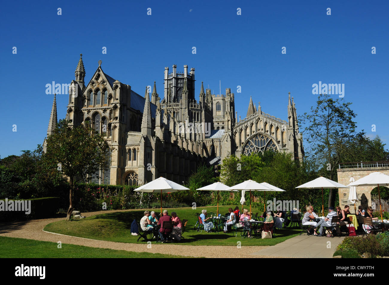 Moon over Ely Cathedral and The Almonry restaurant gardens, Ely, Cambridgeshire, England, UK Stock Photo
