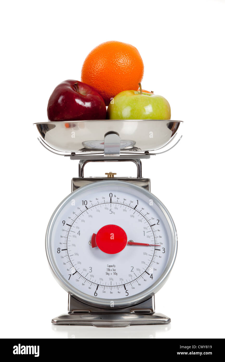 Assorted fruit on a food scale - Stock Image