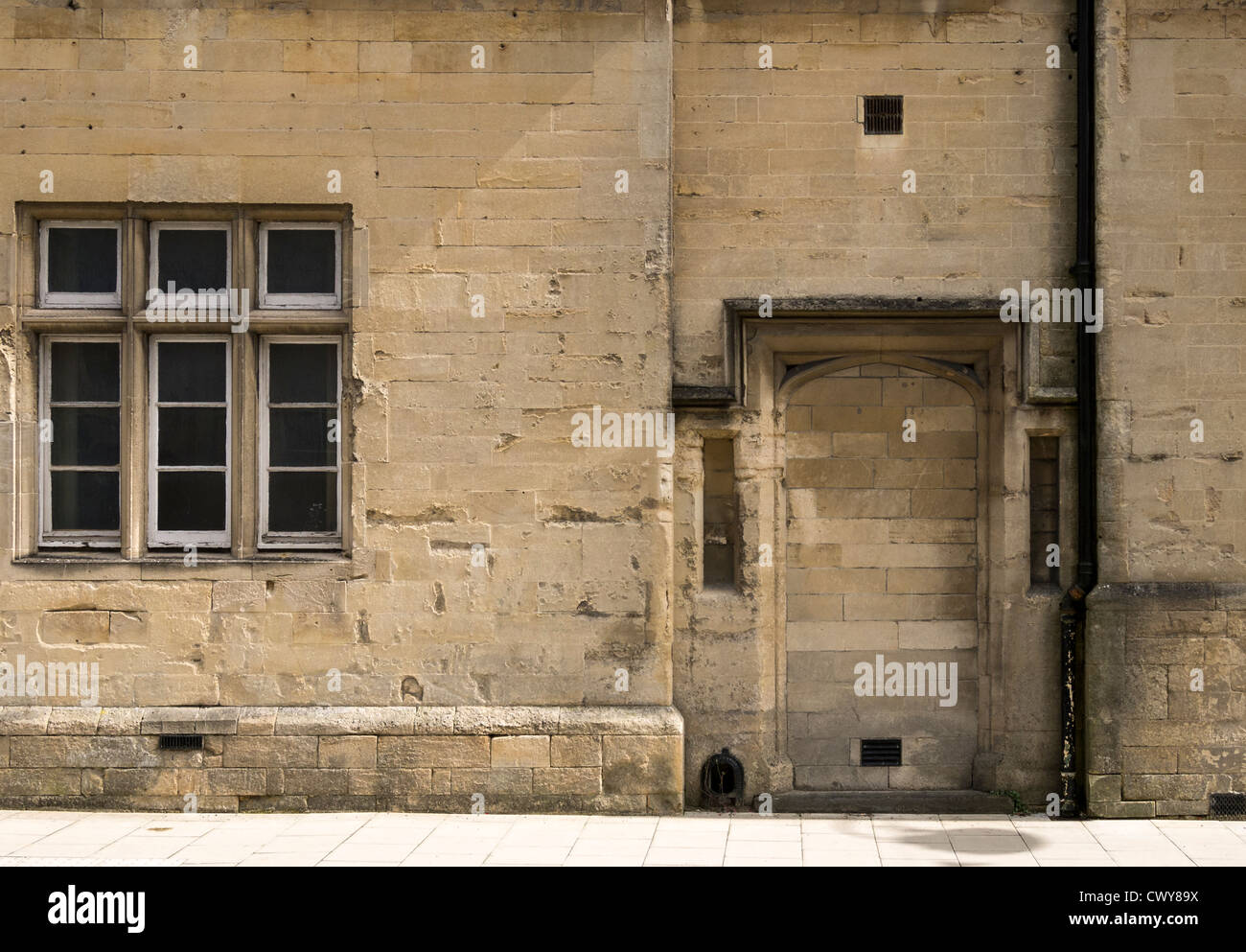 A bricked-up doorway in Jurassic limestone at Devizes, Wiltshire - Stock Image