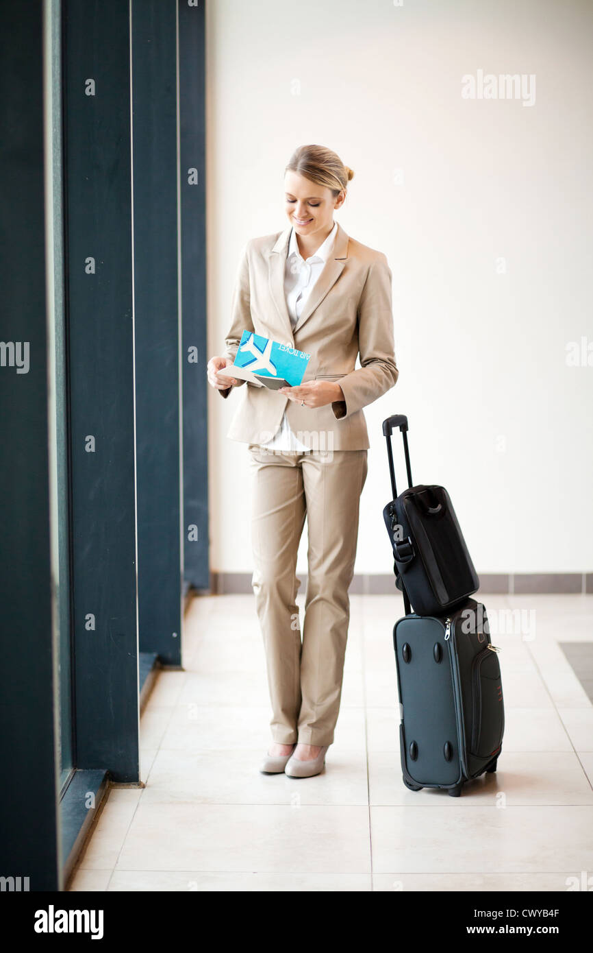 young businesswoman waiting her flight at airport - Stock Image