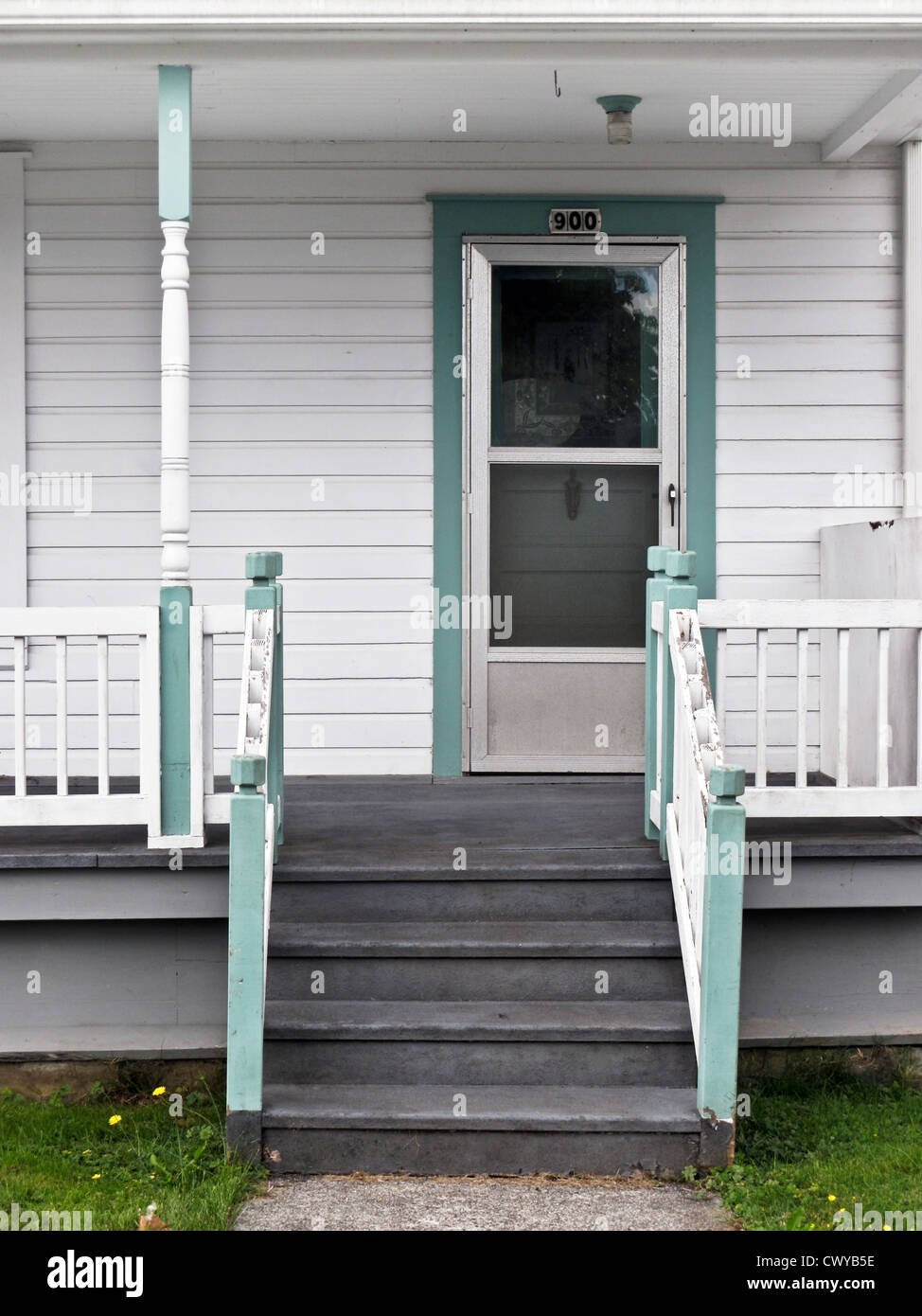 Stairs U0026 Porch Of Simple White Clapboard Victorian House With Original  Entry Door Partly Concealed By New Aluminum Screen Door