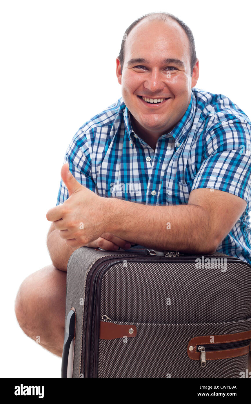 Happy smiling traveller tourist man with luggage, isolated on white background. - Stock Image