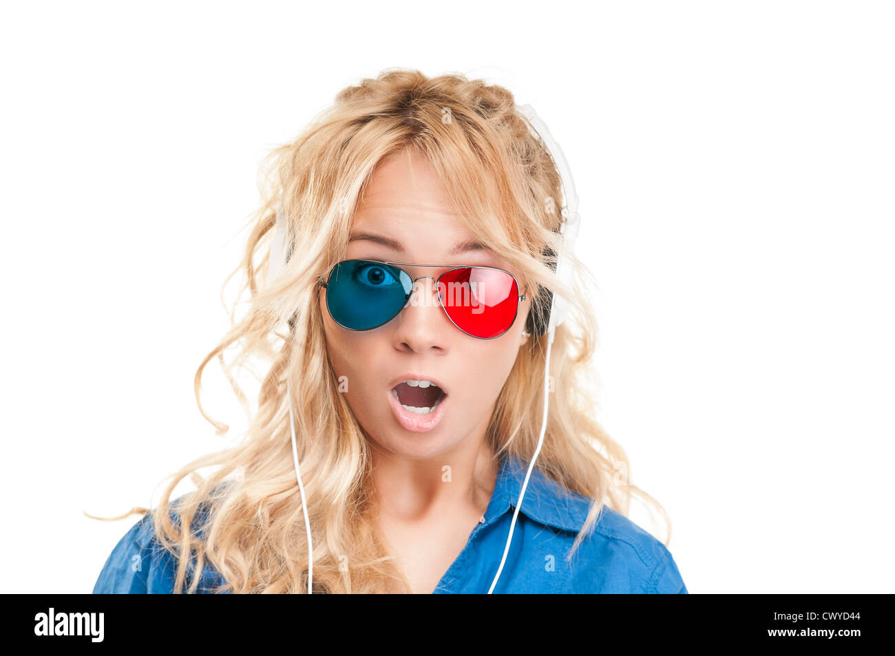 31b5f0937f6 Beautiful and shocked teenage girl watching 3d movie. Wearing 3d glasses  and headphones. Wearing surprised expression and lookin