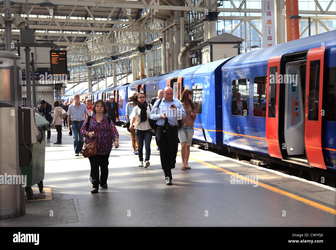 Commuters arriving at Waterloo Station platform in London UK. - Stock Image