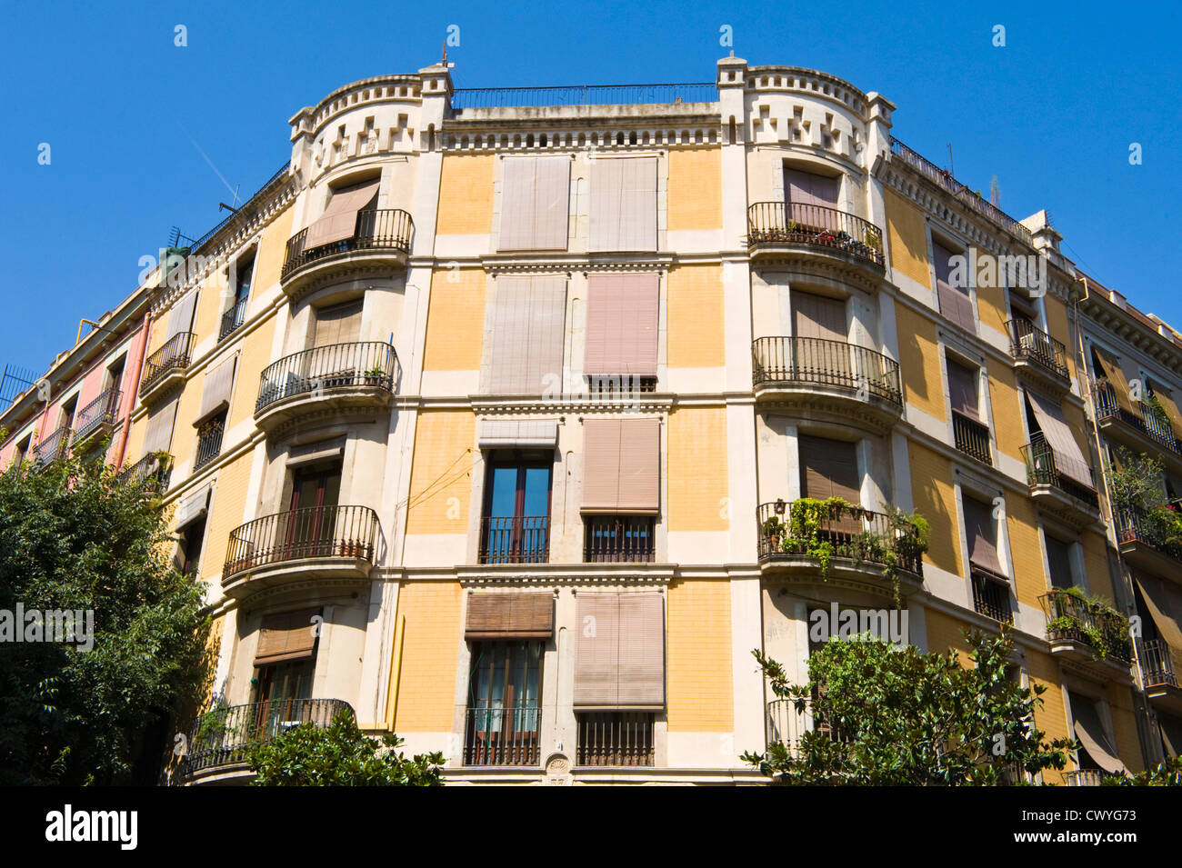 Apartments With Wrought Iron Balconies And Exterior Roller Blinds In