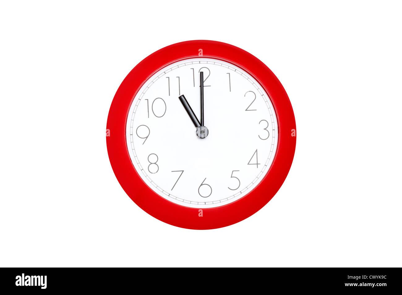 red clock eleven o clock - Stock Image