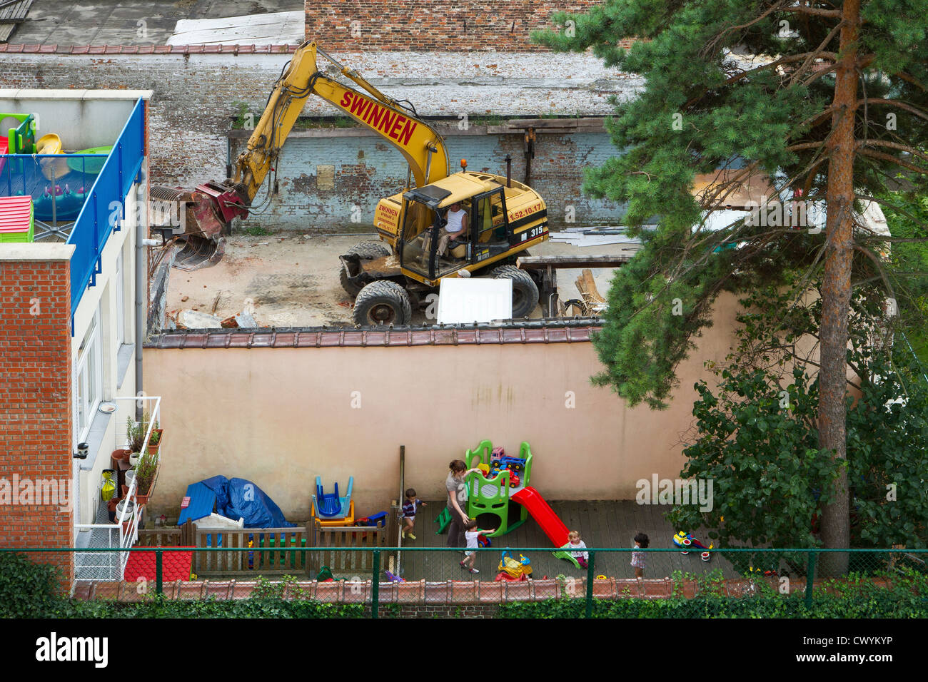 demolition next to creche danger hazard children - Stock Image