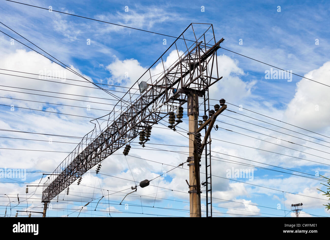 Forefront of a railway catenary with a blue sky Stock Photo