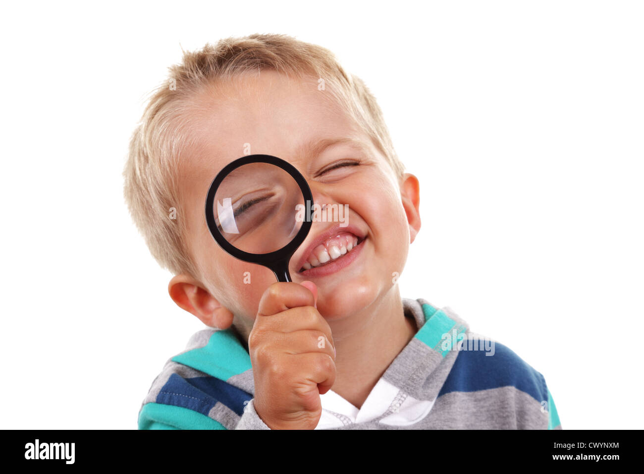 Boy searching with magnifying glass - Stock Image