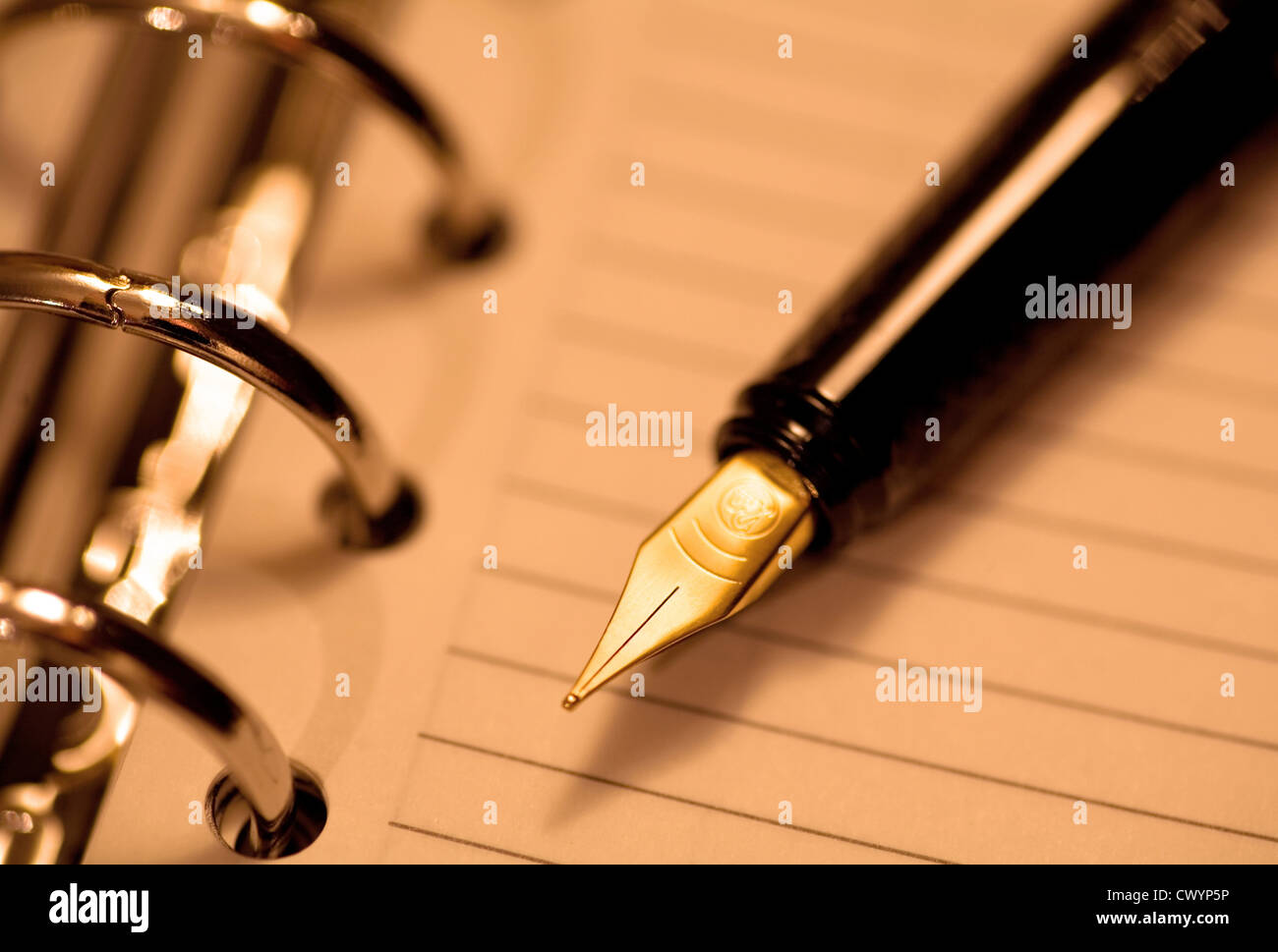 Stylograph on notepad - Stock Image