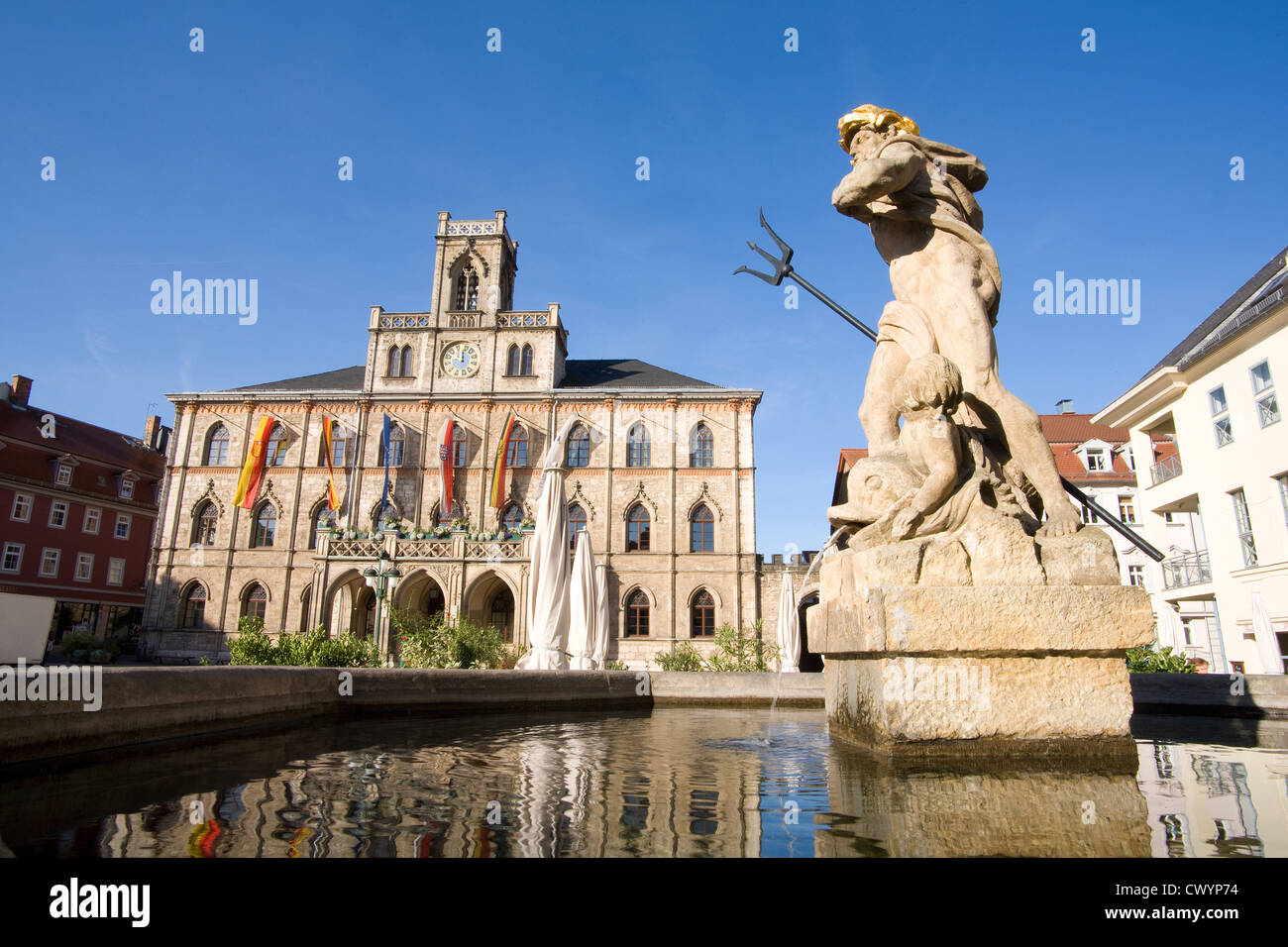 Neptune fountain and town hall on the market square in Weimar, Thuringia, Germany Stock Photo