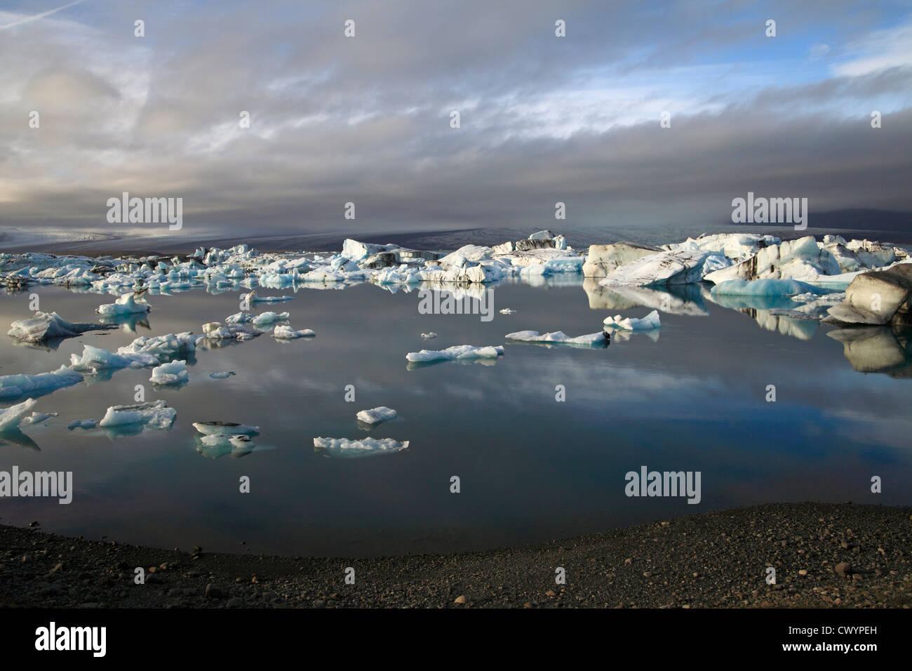 Drift ice in evening light at glacier lake Joekulsarlon, Iceland - Stock Image