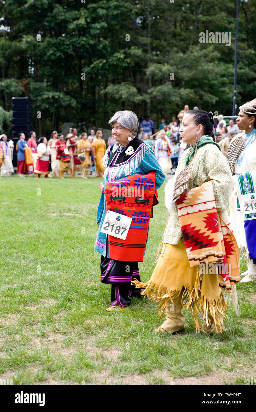 Native American women dressed in traditional regalia participate in Schemitzun 2012 - Stock Image