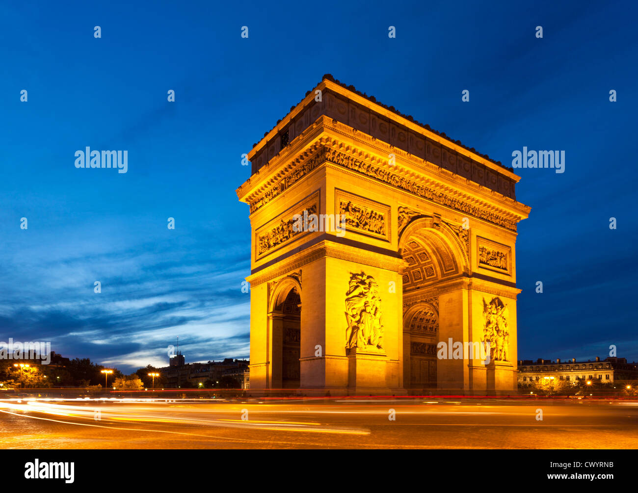 Traffic light trails around Napoleons Arc de Triomphe Place Charles de Gaulle Champs Elysees Paris France EU Europe - Stock Image
