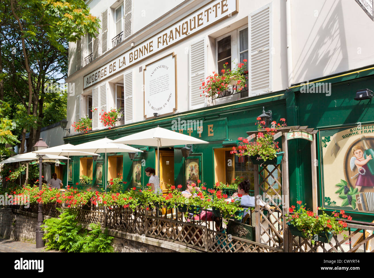 432db4e949 People sitting in a pavement restaurant cafe under umbrellas in Montmartre  Paris France EU Europe -