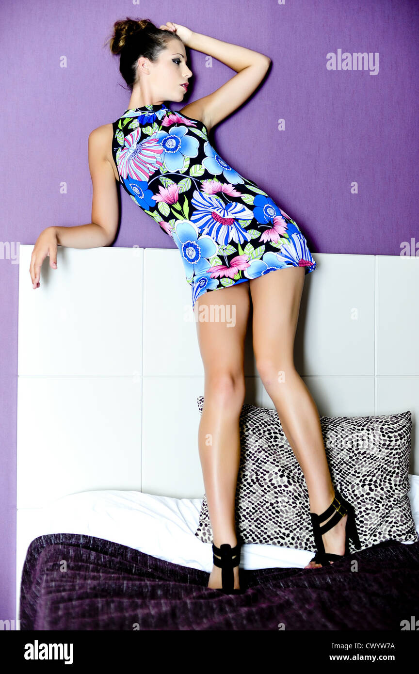 Young woman in minidress, portrait - Stock Image