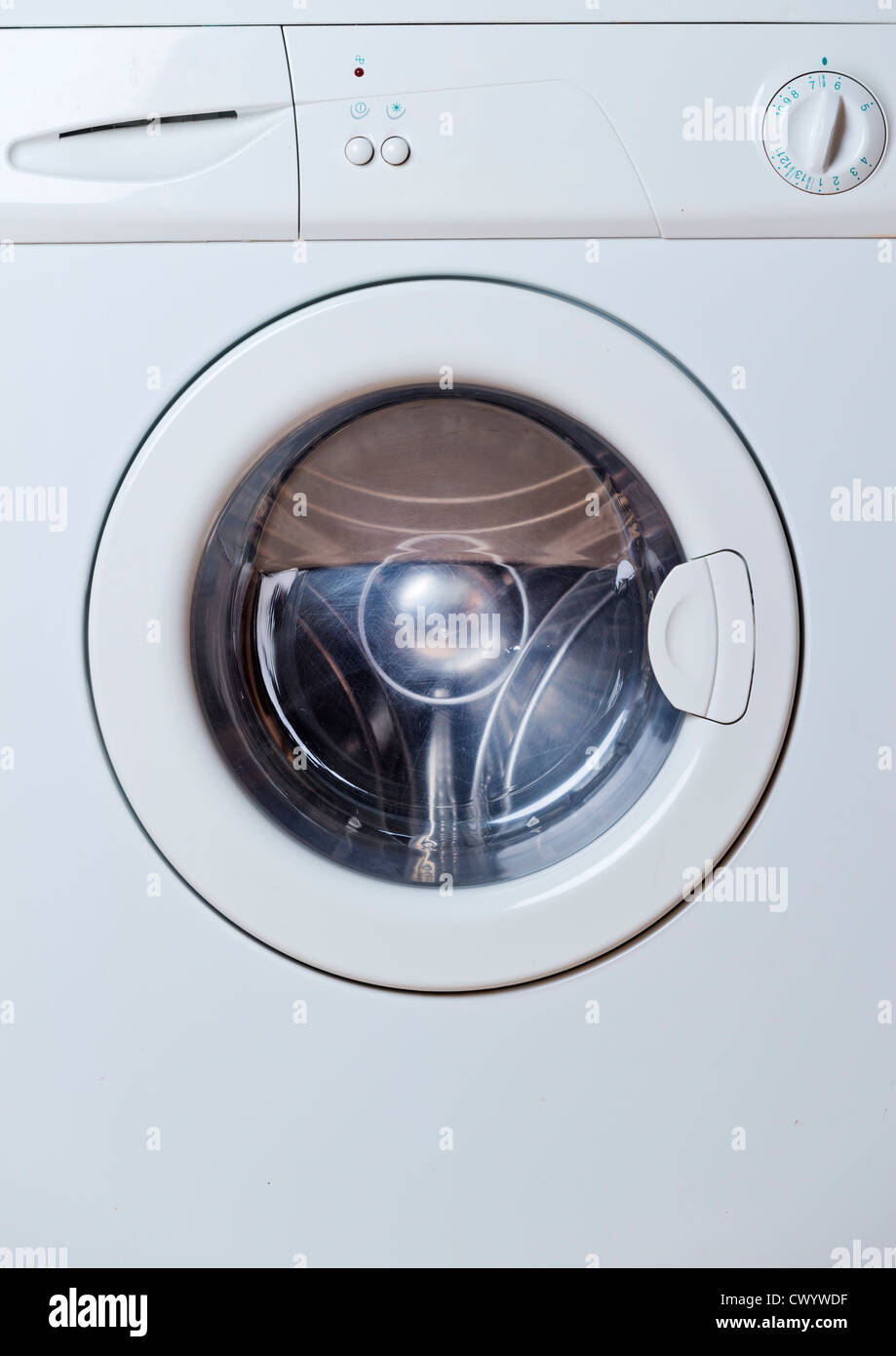 A front loading washing machine. - Stock Image