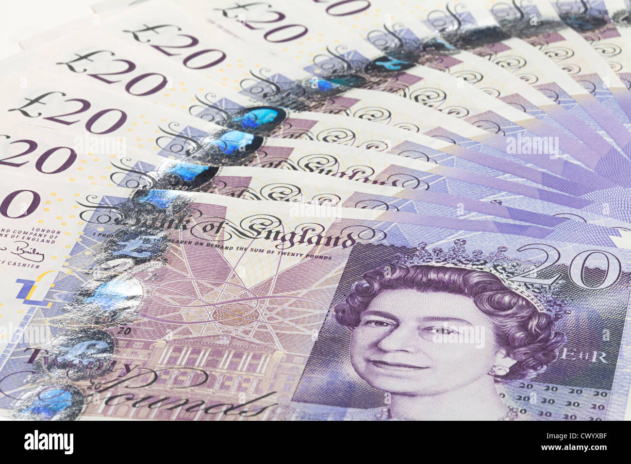 a fan of new unused mint english 20 pound notes - Stock Image