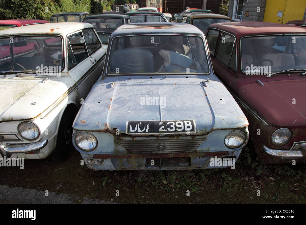 Collection of old Hillman Imp cars awaiting restoration at a garage ...