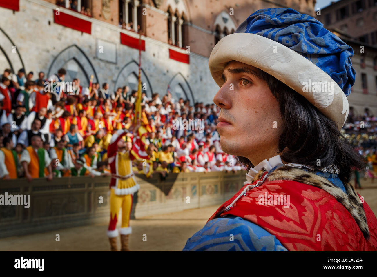 Historic Palio horse race, participants carrying banners,  Piazza Il Campo, Siena, Italy - Stock Image