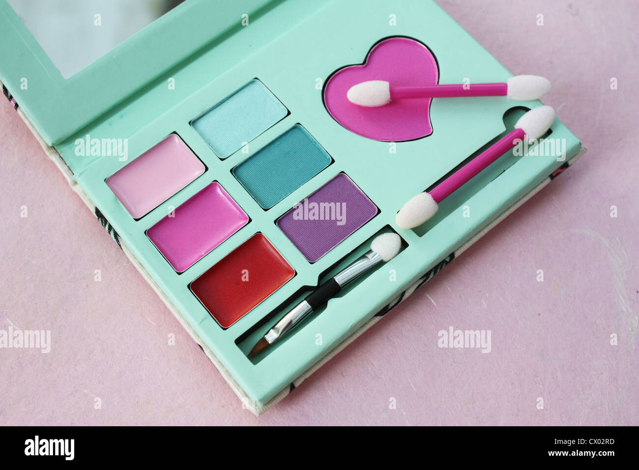 Colorful lipstick and eyeshadow makeup set - Stock Image