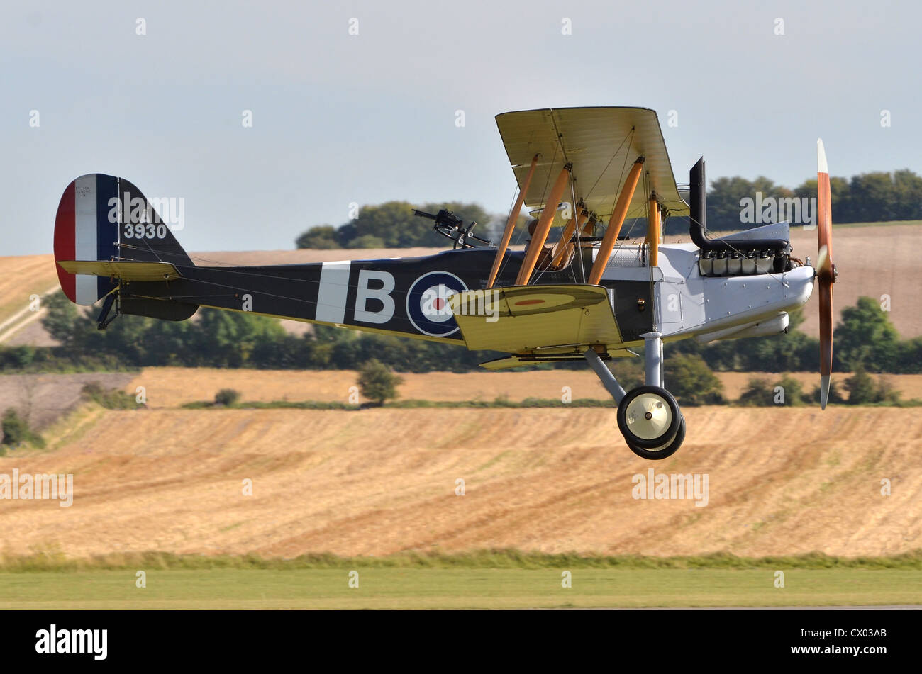 Royal Aircraft Factory R.E.8 WW1 plane in RFC markings landing at Duxford Airshow. The R.E.8 was used as an artillery - Stock Image