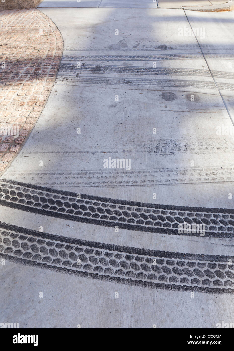 Tire tracks on pavement - Stock Image