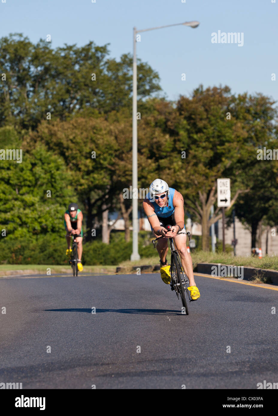 Bicycle racer turning a corner - USA - Stock Image