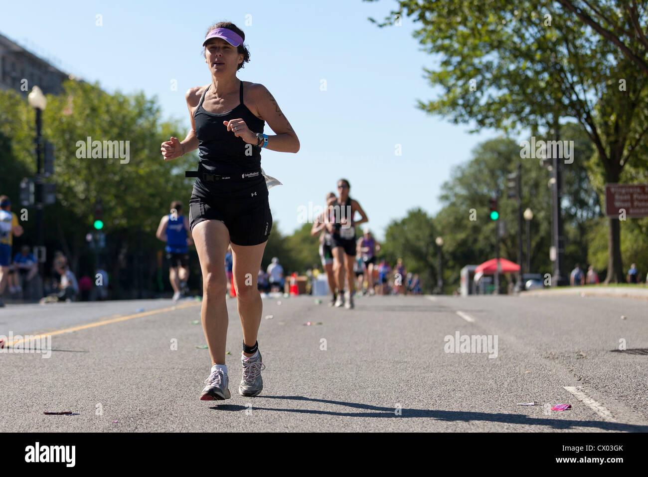 racer running in a marathon - Stock Image