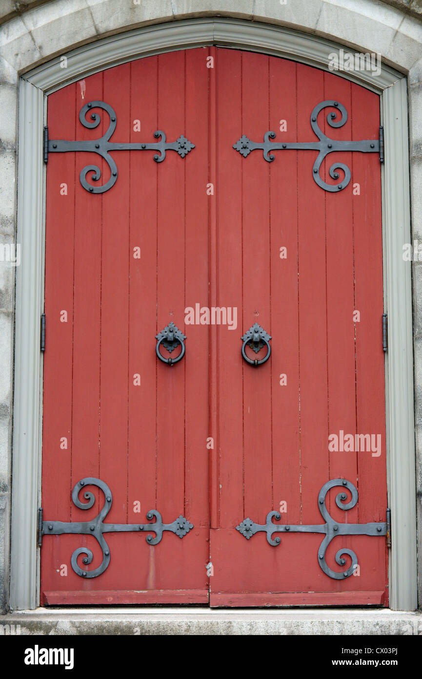 Red side door of the Canadian Memorial Church, Vancouver, BC, Canada - Stock Image