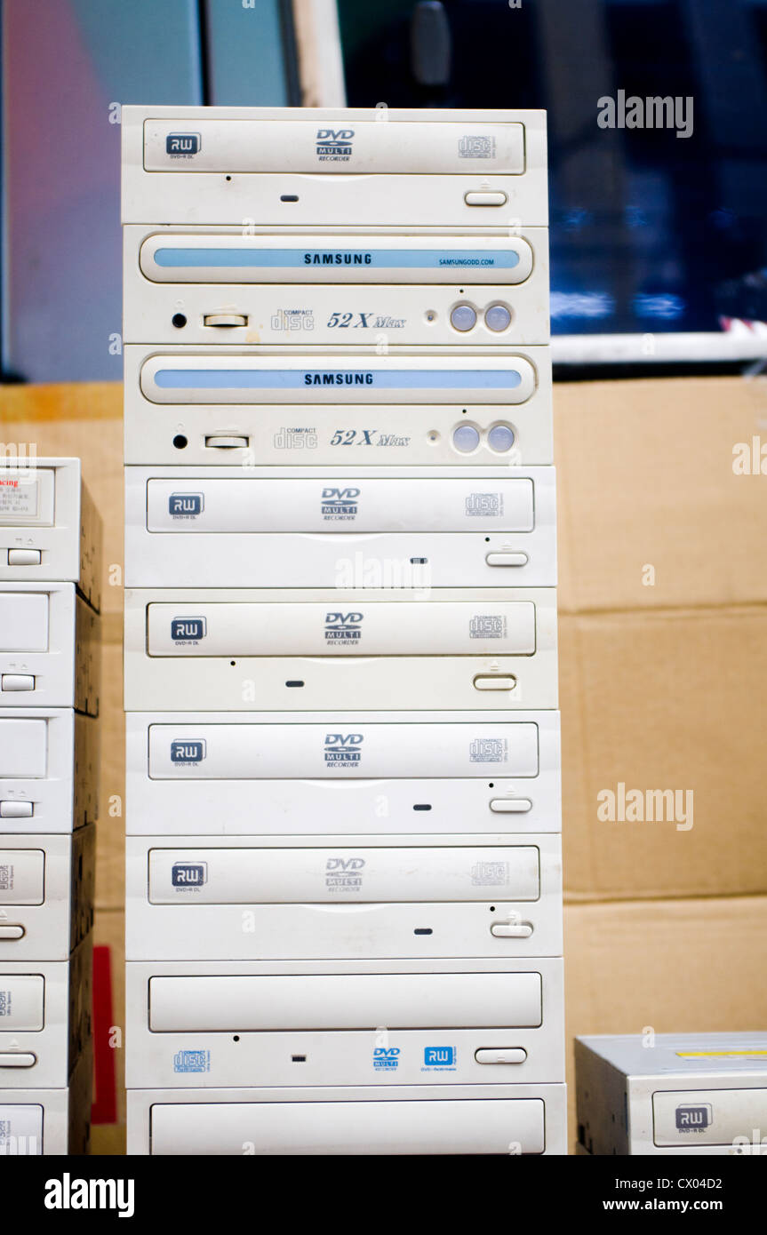a stack of used computer dvd rom player - Stock Image