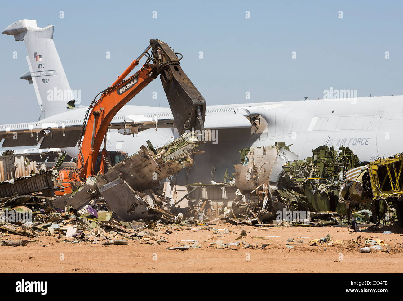 A C-5 Galaxy is broken apart at the 309th Aerospace Maintenance and Regeneration Group (AMARG) at Davis-Monthan - Stock Image